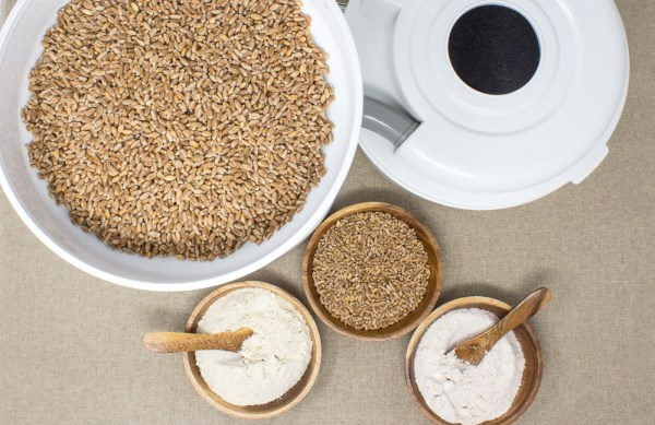 WonderMill Electric Grain Mill Grinding Wheat into Flour
