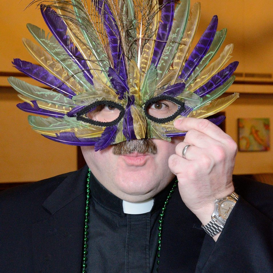 Fr. Jonathan just couldn't resist this mask.. Copyright © 2013 Gary Allman, all rights reserved.
