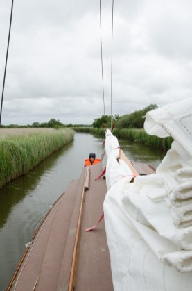 Lanie at the helm - Not sailing on the Norfolk Broads