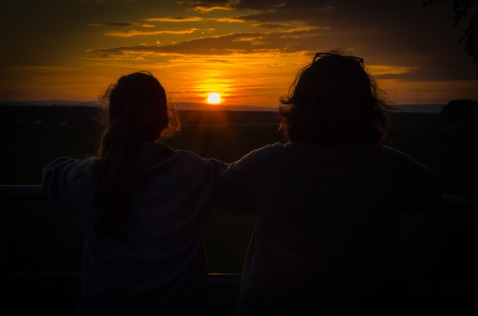 Lanie and Ginger watch the solstice sunset. Copyright © 2014 Gary Allman, all rights reserved.