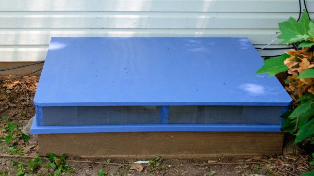 Photograph of a Crawl Space Access Hatch and Fan