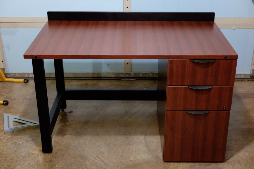 Photograph of a desk built from scrap lumber and parts found at Restore