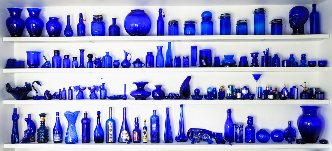 Blue Glass display on four wall mounted shelves