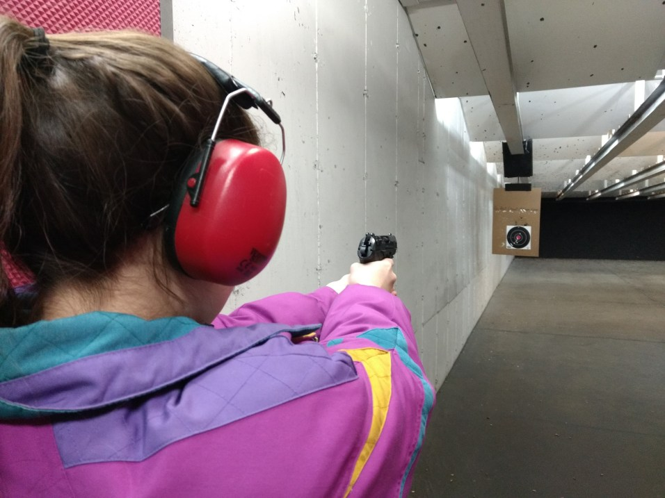 Lanie - on target with the Beretta. Pretty good groupings. Copyright © 2018 Gary Allman, all rights reserved.