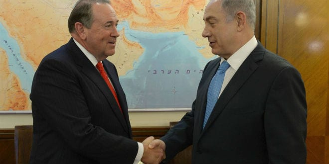 Republican presidential candidate Mike Huckabee (left) meets Israeli Prime Minister Benjamin Netanyahu in August in Israel. (Photo: Prime Minister's Office)