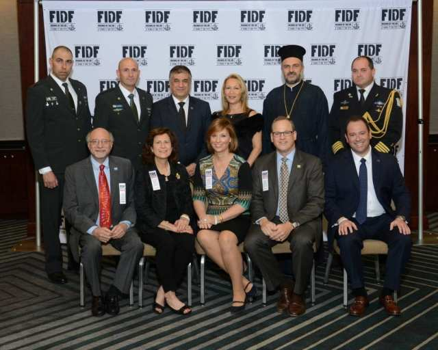 Pictured at the March 28 Friends of the Israel Defense Forces Texas Region gala: (back, from left) IDF Brig. Gen. Muni Katz; IDF Lt. Col. David Sonego; FIDF National Director and CEO Maj. Gen. (Res.) Meir Klifi-Amir; Brig. Gen. (Res.) Gila Klifi-Amir; Father Gabriel Naddaf; and IDF Capt. Gil Aginsky; (front, from left) FIDF Texas Region Gala Dinner chairs Bennet and Robin Greenspan as well as Susan and Max Reichenthal; and FIDF Texas Region Executive Director Scott Kammerman. (Alan Ross)