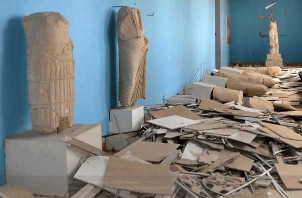 Artifacts destroyed by ISIS. The broken statue of Athena is visible in the far corner. (Twitter/@3dprintindustry)