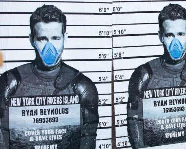 Ryan Reynolds dons a face mask and Deadpool costume