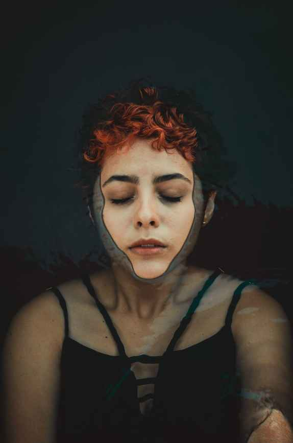 woman floating in the water, depression in the grief process