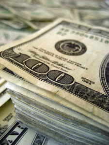 A stack of $100 bills?  Why yes, that's the best image to represent an article on earning royalties as a copywriter!