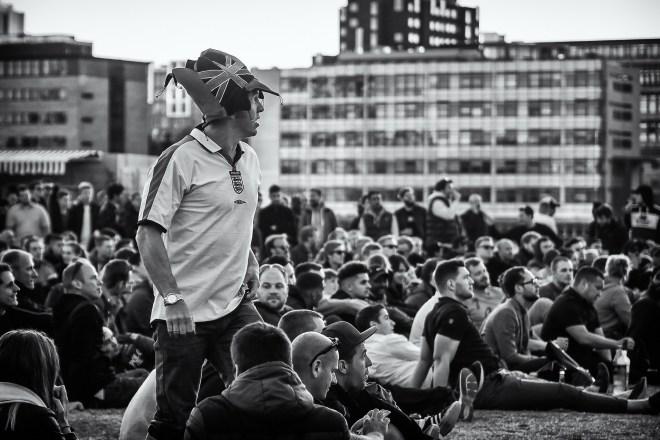 england football supporter watching open-air screen