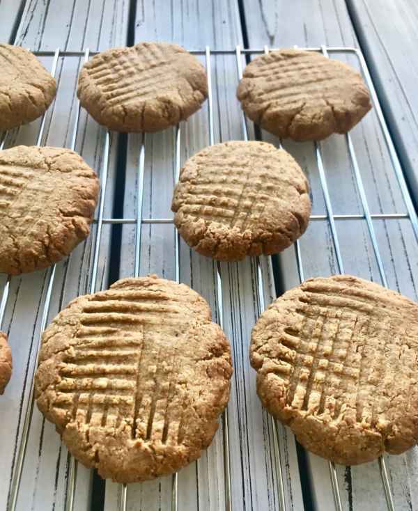 Vegan peanut butter cookies on a cooling rack.