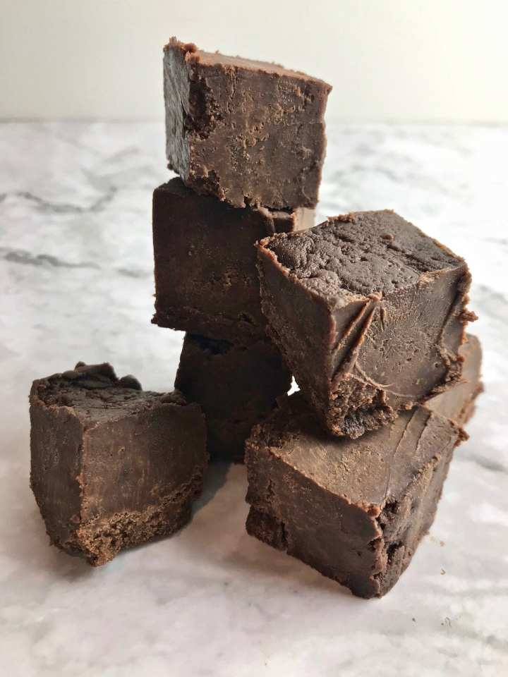 Squares of fudge stacked on top of each other.