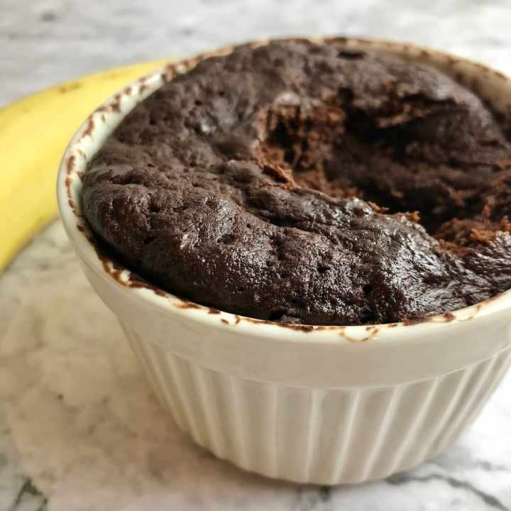Close up of flourless chocolate banana mug cake in a ramekin.