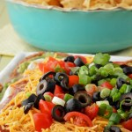 This Exposed Seven Layer Dip adds an extra pop of Mexican flavors like chili powder, cumin, cilantro, garlic and onion. Expose all those layers of beans, guacamole, sour cream, and salsa for some extra party fun.
