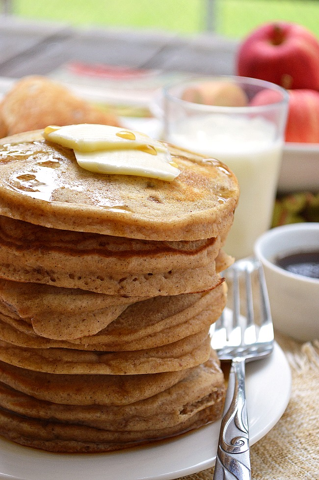 Welcome those cool fall mornings with these warm and toasty Gluten Free Cinnamon Apple Pancakes. It's all the flavors of fall in one bite!