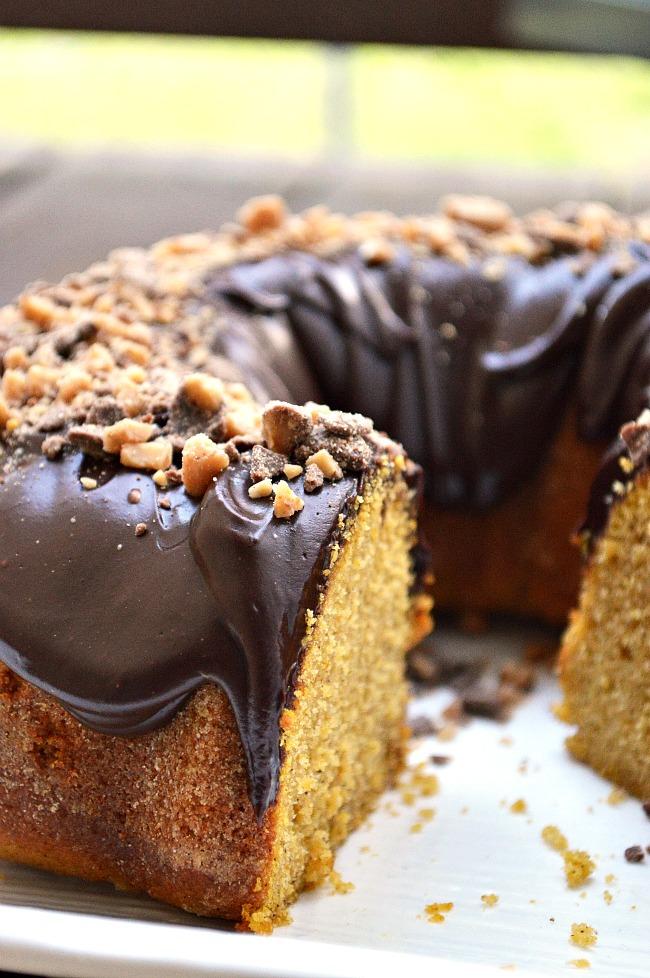 This Gluten Free Sour Cream Pumpkin Bundt Cake is a tender, moist, pumpkin spiced bundt cake topped with a creamy semi-sweet chocolate ganache and Heath bits.