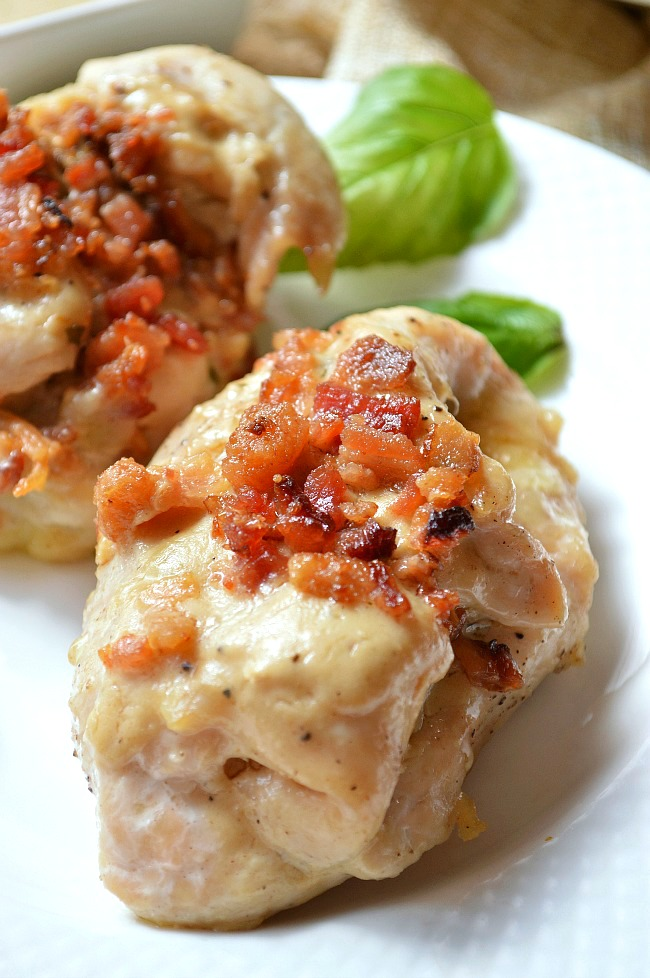 These Gluten Free Sundried Tomato and Basil Stuffed Chicken Breasts make a flavorful fancy dinner for any day of the week. Top it off with some basil cream sauce and crumbled bacon for even more flavor.
