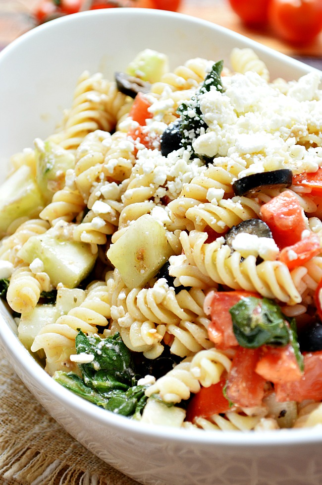 This Gluten Free Cucumber and Feta Spinach Pasta Salad is a tangy twist on your ordinary pasta salad, combining flavors from your favorite Italian and Greek Salads. Plus it stays good for days in the fridge!
