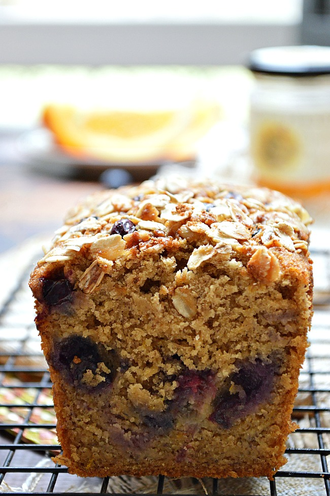 You won't miss the dairy, refined sugar, or butter in this Gluten Free Honey Orange Ginger Blueberry Banana Bread. It's a perfectly flavorful, guilt free snack for your entire family...or just you!