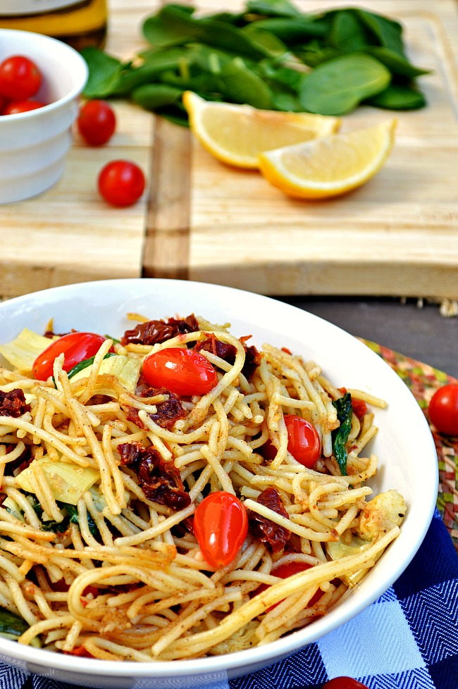 Lighten your load and reduce some stress with this quick and easy 30 minute meal. There's all kinds of flavor in this vegetarian Gluten Free Browned Butter Artichoke, Spinach, and Tomato Pasta.