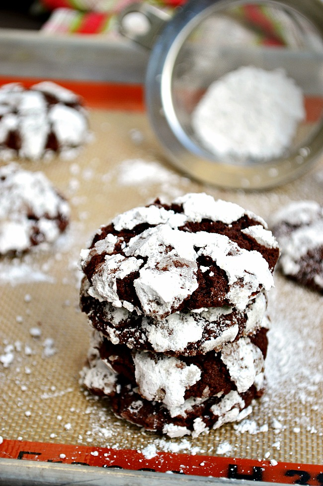 These ultra fudgy and chewy, brownie-like Gluten Free Snowcap Chocolate Crinkle Cookies are a melt in your mouth decadent treat. Jazz them up with a splash of peppermint extract for a little more fun.