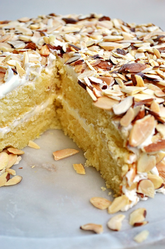 This Gluten Free Sour Cream Lemon Cake with Lemon Cream Cheese Frosting is bursting with citrus flavor, coated in a smooth and tangy frosting, and topped with the most delicious crunchy toasted almonds. It's a party indeed!