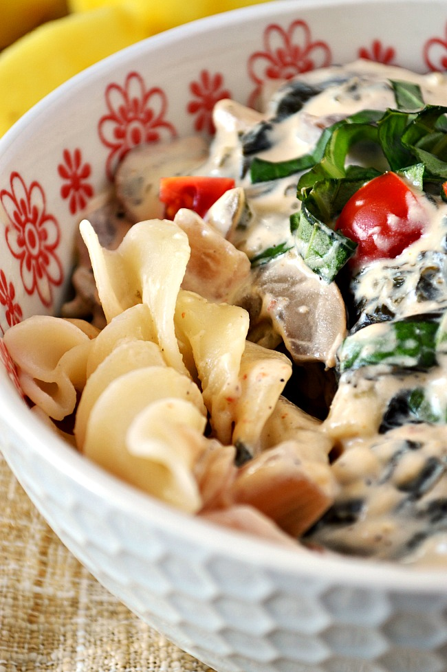 Sit at home and enjoy this restaurant quality Gluten Free Creamy Lemon, Caper, & Spinach Pasta. It velvety and tangy and oh so comforting!