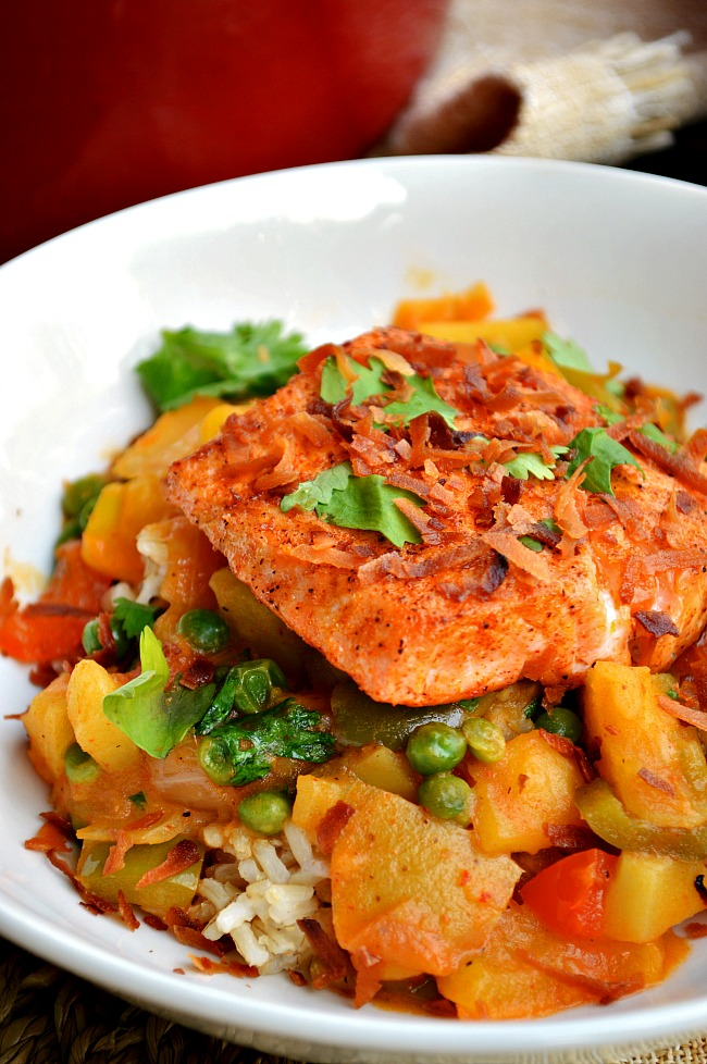 Throw together this intensely easy and happily healthy Thai Coconut Curry with Pan Seared Salmon. A sweet, veggie packed coconut curry over coconut flavored brown rice and topped with a pan seared salmon filet. Hello flavor!