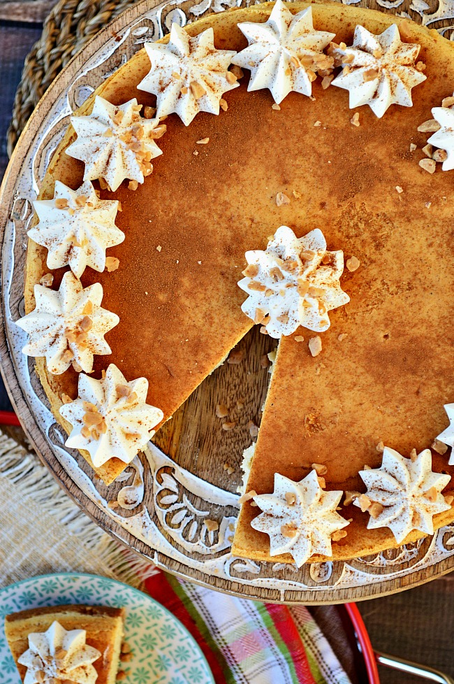 If you need a show stopper for your next holiday party, consider showing up with this Gluten Free Eggnog Cheesecake topped with cinnamon and whipped cream.