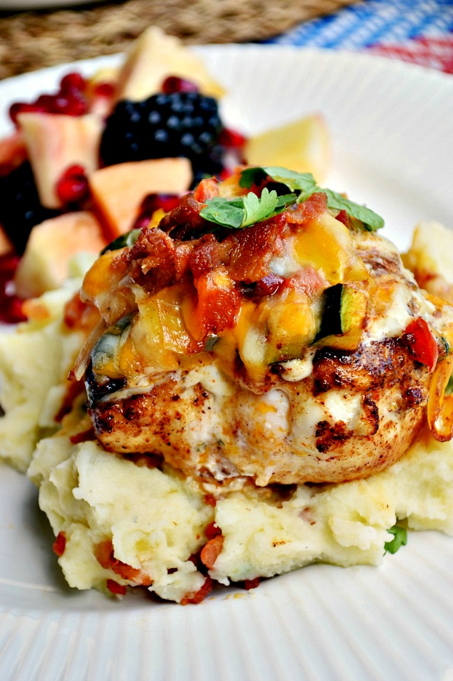 Enjoy this one pot Tex-Mex meal with this Southwest Chicken and Ranch Veggie Skillet. Pan seared chicken topped with sauteed veggies, ranch dressing, Mexican cheese and bacon!