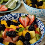 Whip up a fresh bowl of this Mojito Tropical Fruit Salad for a real summer treat. It's sweet, tangy, and the perfect side dish for those hot summer days.