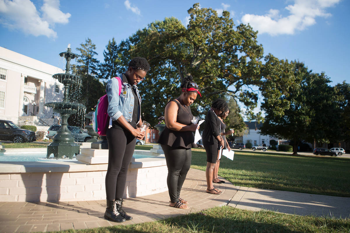 Students bow their heads for a moment of silence. (AJ Reynolds/Brenau University)