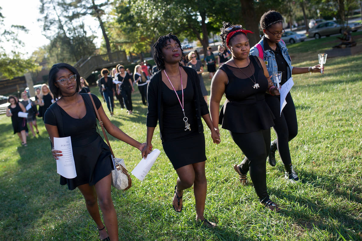 From left to right, Chyna Brooks, Kenya Hunter, Peyton Edmond, Diamond Wood, all members of the Brenau's Black Student Association, hold hands and match together during the Vigil for Lives Lost. (AJ Reynolds/Brenau University)