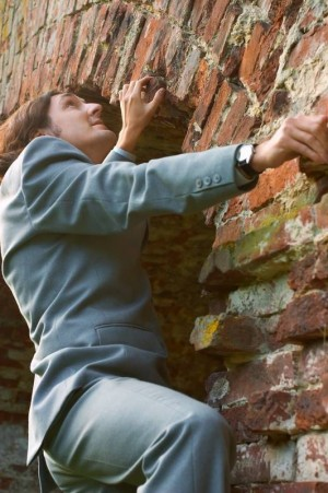 meditation for businessman climbing the wall