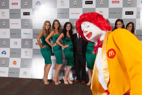 Ronald McDonald Photobombing a shoot with The Emeralds cheerleader squad for the Canberra Raiders at the Ronald McDonald House Charities Lexus of Canberra Gala Ball held here in Canberra at The National Convention Center