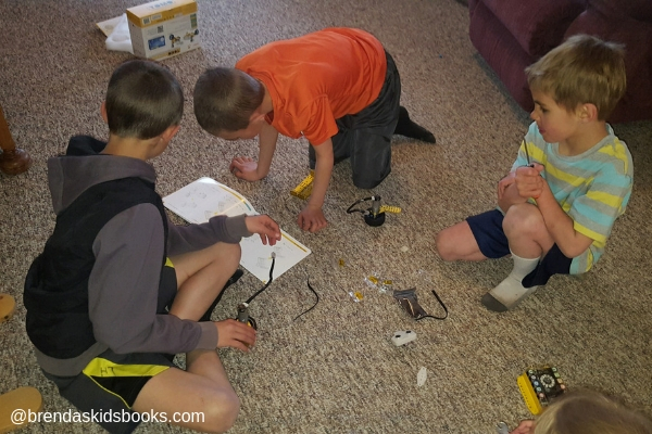 3 boys working on the Robot