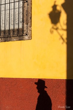 Man shadow on colorful wall.