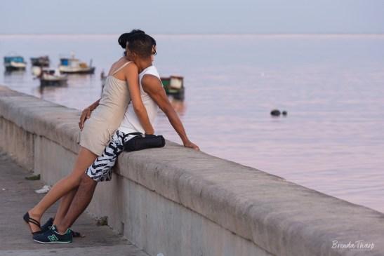 A couple embraces along the Malecón, Havana, Cuba.