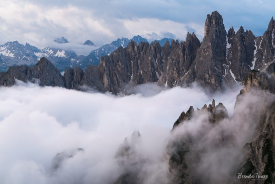 Fog and rugged peaks in Dolomite mountains.