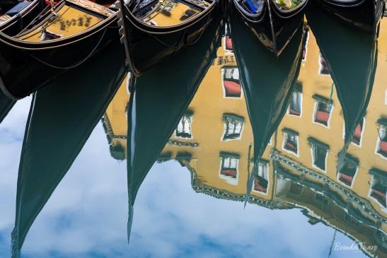 Gondolas Reflected in Water, Venice.