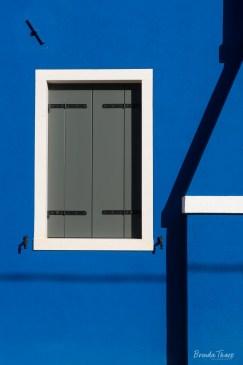 Brilliant blue wall with window, Burano.