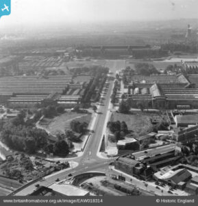 North End Road (left), joins Bridge Road (diagonal lower left to upper right), at a junction with Olympic Way (above). Wembley Stadium in the background and Wembley Park Station just visible at bottom. 1948, Britain from Above, EAW018314.