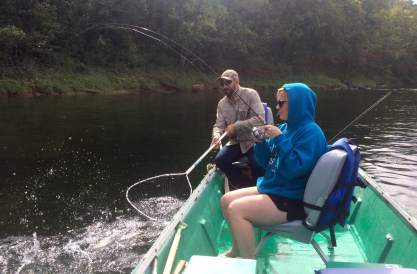 Jenny Frazee Schiltz fought a trout on the White River as guide Steve Lopez sat ready with the net.
