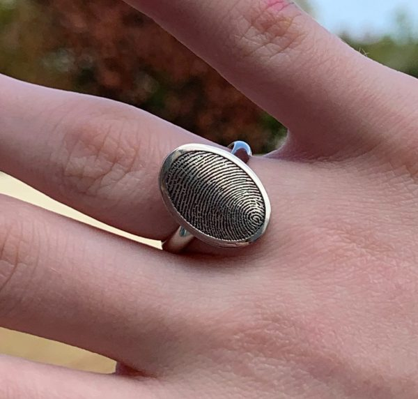 Custom Oval fingerprint signet ring on a hand