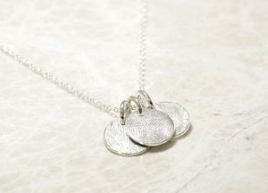 Custom Brent&Jess family fingerprints charm necklace.