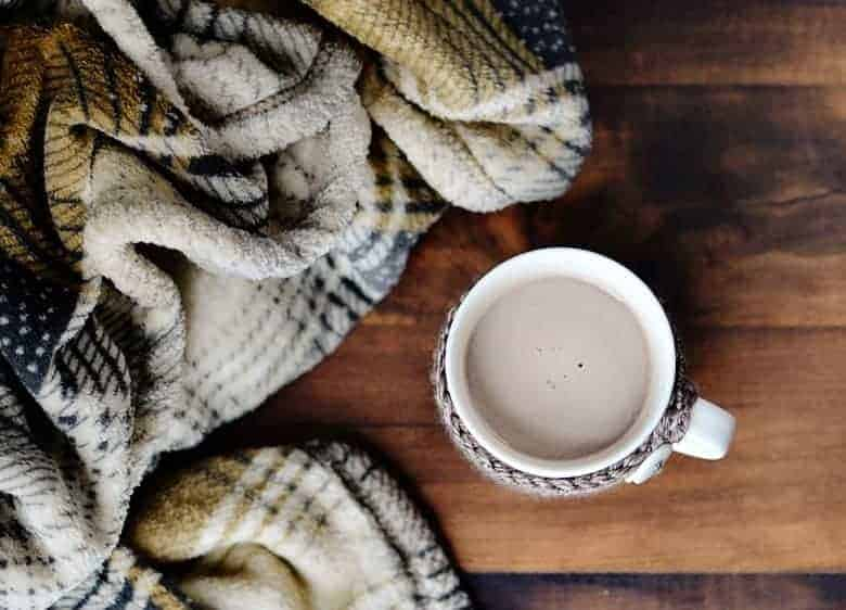 Keep your Starbucks Hot Cocoa warm with this free crochet pattern for a tall coffee mug cozy with buttons!