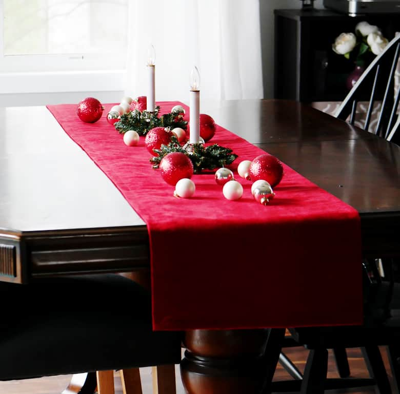 This Knock Off DIY Pottery Barn Velvet Table Runner can be made for under $20!
