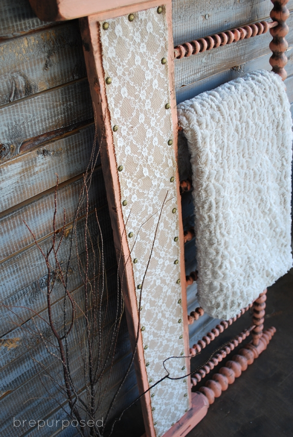 DIY Headboard Turned Quilt Rack