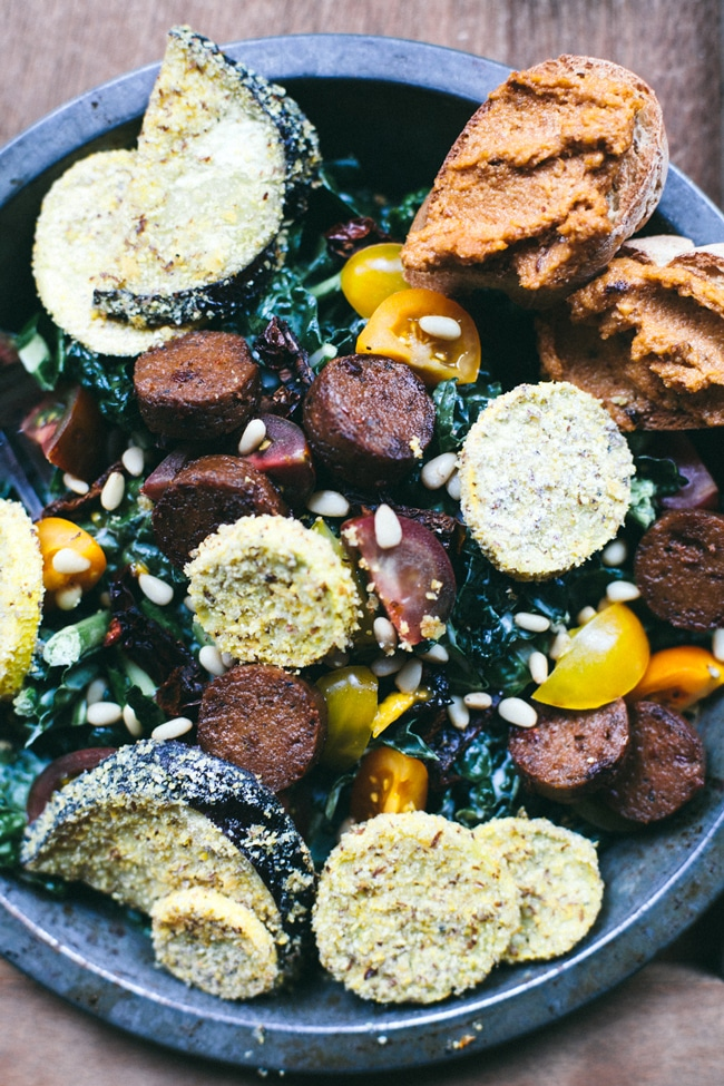 garlicky kale with cornmeal crusted veggies, italian veggie sausage, heirloom tomatoes and pine nuts